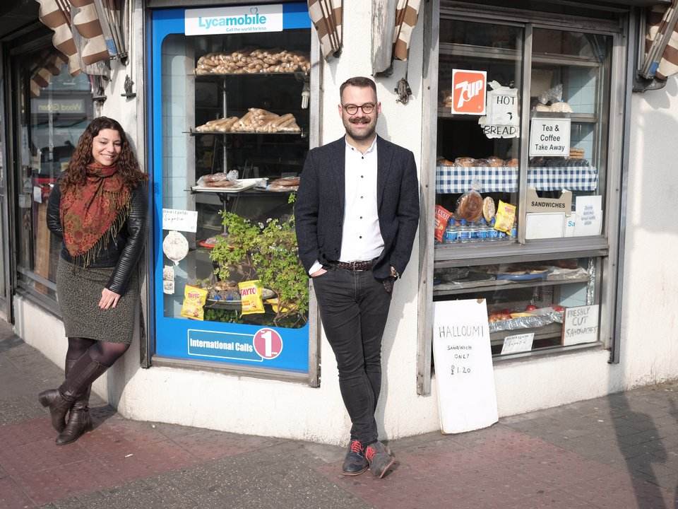 Petros and Anna outside shop front